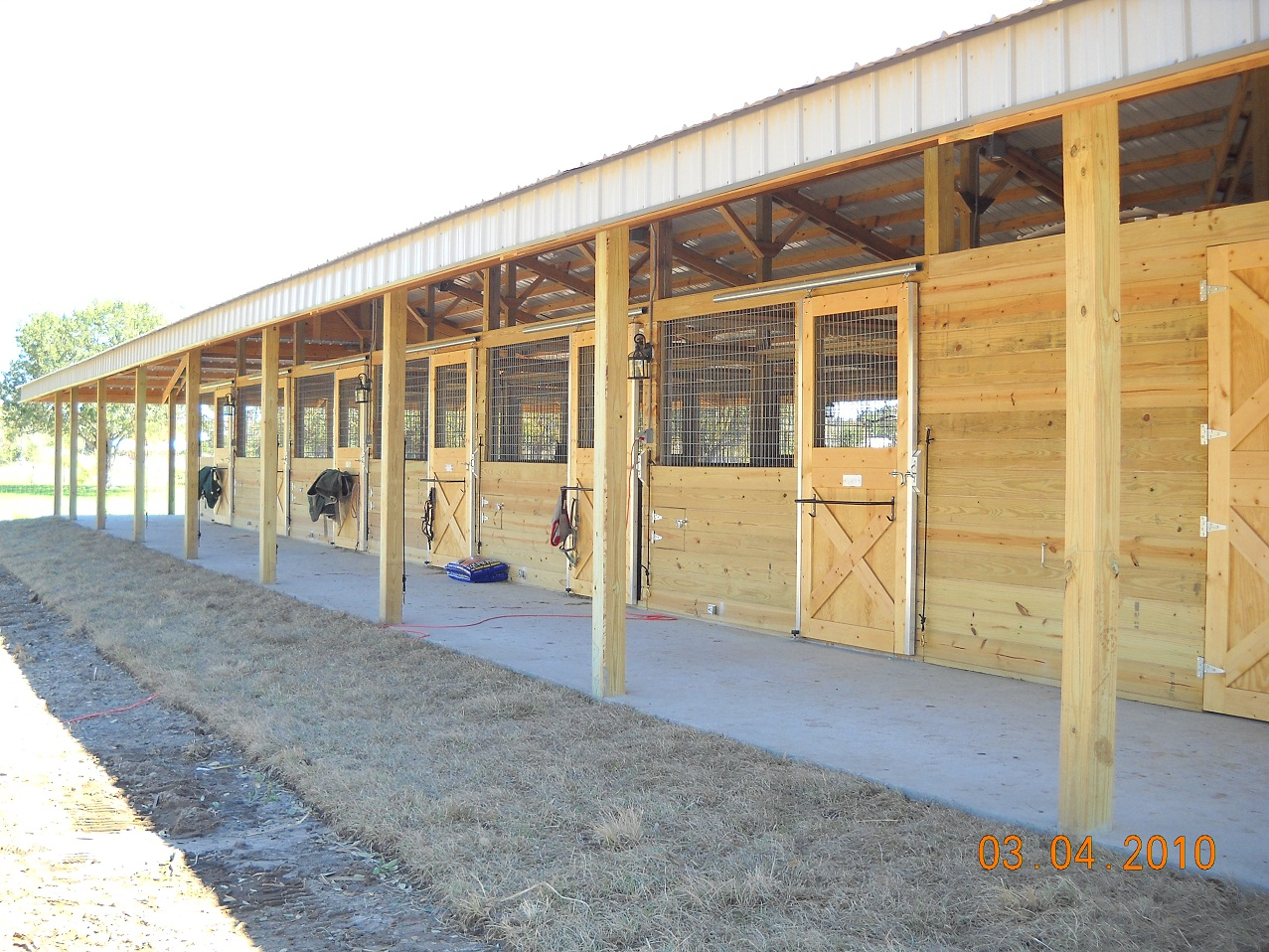Woodys barns horse barns for Horse shed